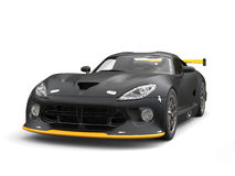 Matte black modern race supercar with yellow details - beauty shot Stock Images