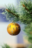 Matte yellow Christmas ball Stock Image