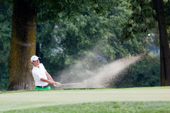 Matteo Manassero (ITA) blast out of the bunker on the 4th hole. Stock Photography