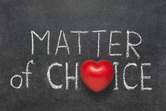 Matter of choice. Phrase handwritten on blackboard with heart symbol instead O Royalty Free Stock Photos