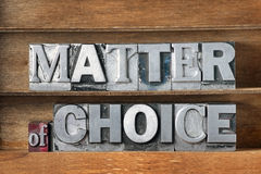 Matter of choice tray. Matter of choice phrase made from metallic letterpress type on wooden tray Stock Image