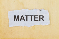 Matter. Concept-  newspaper cutout in an old paper background Stock Photos