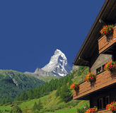 Matterhorn. And a chalet on a clear summer day in the Swiss Alps Royalty Free Stock Photo