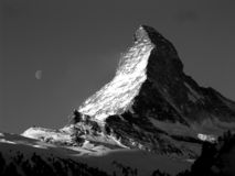 Matterhorn. Black and White photo of Matterhorn and Moon Royalty Free Stock Photos