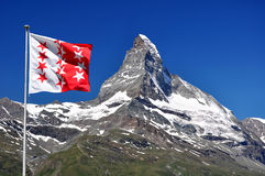 Matterhorn. Beautiful mountain Matterhorn with Wallis flag - Swiss Alps Stock Images