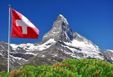 Matterhorn. Beautiful mountain Matterhorn with Swiss flag - Swiss Alps Royalty Free Stock Photo