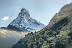 Matterhorn against sunset in Swiss Alps, Zermatt area, Switzerland. Famous Matterhorn against sunset in Swiss Alps, Zermatt area, Switzerland royalty free stock images