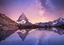 Free Matterhorn And Reflection On The Water Surface At The Night Time. Milky Way Above Matterhorn, Switzerland. Stock Photos - 125860363