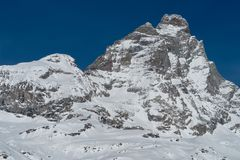The Matterhorn from Breuil-Cervinia, Italy. Matterhorn seen from Breuil in winter. On the left is the Lion`s Head Royalty Free Stock Images