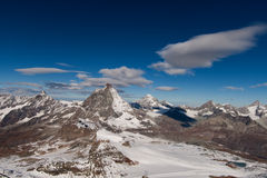 Matterhorn covered with clouds on a clear day after snow fall in autumn Stock Images