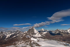 Matterhorn covered with clouds on a clear day after snow fall in autumn,  Valais Royalty Free Stock Images
