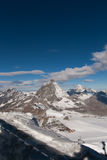 Matterhorn covered with clouds on a clear day after snow fall in autumn,  Valais Stock Images