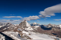 Matterhorn covered with clouds on a clear day after snow fall in autumn,  Valais Royalty Free Stock Photos