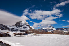 Matterhorn covered with clouds on a clear day after snow fall in autumn,  Valais Royalty Free Stock Photography