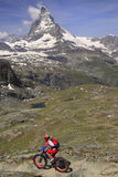 Matterhorn and cyclist in Switzerland, Europe Royalty Free Stock Photo