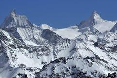 Matterhorn and Dent d'Herens. The matterhorn and the Dent d'Herens in the Swiss alps in the winter Stock Image