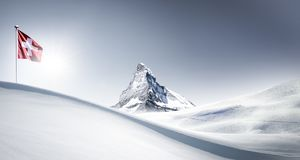 Matterhorn with Flag in winter royalty free stock photos