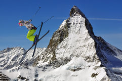 Matterhorn and girls ski jumper. Matterhorn and a girl ski jumper Royalty Free Stock Photos
