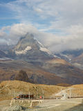 Matterhorn and Gornergratbahn. Matterhorn towering above the Gornergratbahn, a narrow gauge mountain rack railway, approaching the Gornergrat summit station stock image