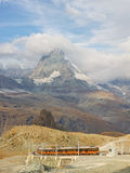 Matterhorn and Gornergratbahn. ZERMATT, SWITZERLAND - SEP 17: The Gornergratbahn, a narrow gauge mountain rack railway, approaches the Gornergrat summit station royalty free stock photo