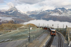 Matterhorn and Gornergratbahn. The Gornergratbahn, a narrow gauge mountain rack railway, approaching the Gornergrat summit station. Matterhorn in the background royalty free stock images