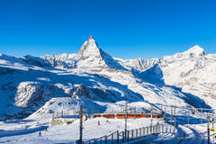 Matterhorn and Gornergratbahn. Zermatt, Switzerland - December 31, 2014 -The train of Gonergratbahn running to the Gornergrat station in the famous touristic royalty free stock image