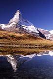 Matterhorn with hikers. Hikers beneath Matterhorn at Leisee lake, Zermatt, Switzerland Stock Photography