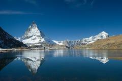 Matterhorn with Lake Riffelsee. Lake Riffel Riffelsee in German with Matterhorn and Dent Blanche near Gornergrat Royalty Free Stock Photos