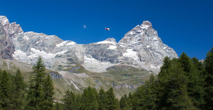 Matterhorn. Landscape of Matterhorn with a rescue helicopter.  Monte Cervino, the italian name, is a mountain of the Alps, straddling the border between Royalty Free Stock Images