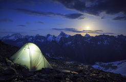 Matterhorn moonrise. Campsite and the moon rising above the Matterhorn in Wallis, Switzerland. Outdoor and adventure concept Stock Photos