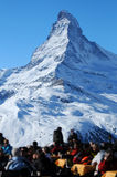 Matterhorn mountain. Scenic view of Matterhorn mountain with tourists in foreground, Pennine, Alps, Switzerland and France Royalty Free Stock Images