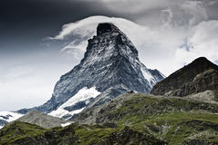 Matterhorn mountain view. Dramatic weather over the Matterhorn, famous mountain in Swiss Alps Royalty Free Stock Images