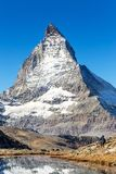 Matterhorn mountain view from Riffelsee lake on high mountain in royalty free stock photos