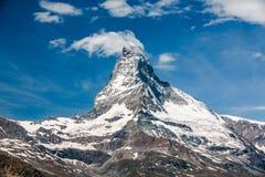 Matterhorn, neu erstellte Wolke und Flugzeug oben Stockfotos