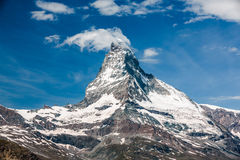 Matterhorn, newly created cloud and airplane above Stock Photos