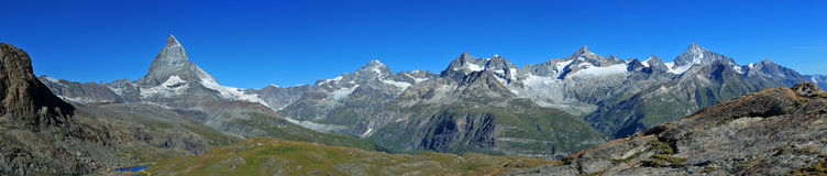 Matterhorn and other peaks. Big panorama with Matterhorn and other 4000-meter-peaks, seen from Gornergrat near Zermatt, Vallais, Switzerland Royalty Free Stock Photos