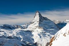 Matterhorn peak. Matterhorn is a mountain in the Pennine Alps on the border between Switzerland and Italy. Its summit is 4,478 meters high. The Matterhorn has Stock Photography