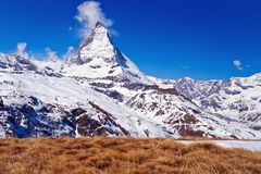 Matterhorn peak with dry meadow Stock Photos
