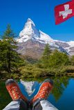 Matterhorn peak with hiking boots in Swiss Alps. Famous Matterhorn peak with hiking boots in Swiss Alps royalty free stock images