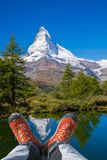 Matterhorn peak with hiking boots in Swiss Alps. Famous Matterhorn peak with hiking boots in Swiss Alps royalty free stock photography