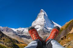 Matterhorn peak with hiking boots in Swiss Alps. Famous Matterhorn peak Matterhorn peak with hiking boots in Swiss Alps stock photography