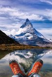 Matterhorn peak with hiking boots in Swiss Alps. Famous Matterhorn peak with hiking boots in Swiss Alps stock photography