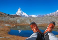 Matterhorn peak with hiking boots in Swiss Alps. Famous Matterhorn peak with hiking boots in Swiss Alps stock photo