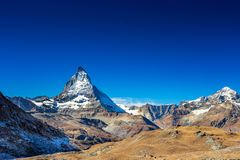 Matterhorn peak mountain in summer with clear blue sky and day moon at Zermatt Switzerland, Europe stock images