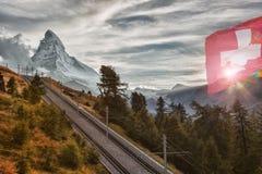 Matterhorn peak with railway with sunset in Swiss Alps, Switzerland. Matterhorn peak with railway against sunset in Swiss Alps, Switzerland stock images