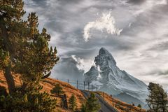 Matterhorn peak with railway with sunset in Swiss Alps, Switzerland. Matterhorn peak with railway against sunset in Swiss Alps, Switzerland royalty free stock photos