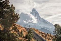 Matterhorn peak with railway against sunset in Swiss Alps, Switzerland. Famous Matterhorn peak with railway against sunset in Swiss Alps, Switzerland stock images
