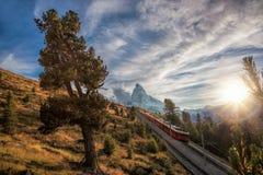 Matterhorn peak with railway against sunset in Swiss Alps, Switzerland. Famous Matterhorn peak with railway against sunset in Swiss Alps, Switzerland stock photos