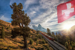 Matterhorn peak with railway against sunset in Swiss Alps, Switzerland. Famous Matterhorn peak with railway against sunset in Swiss Alps, Switzerland stock photography