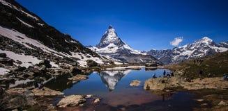 Matterhorn Peak reflection in summer at Riffelsee lake, Gornergrat station, Zermatt, Switzerland Stock Image